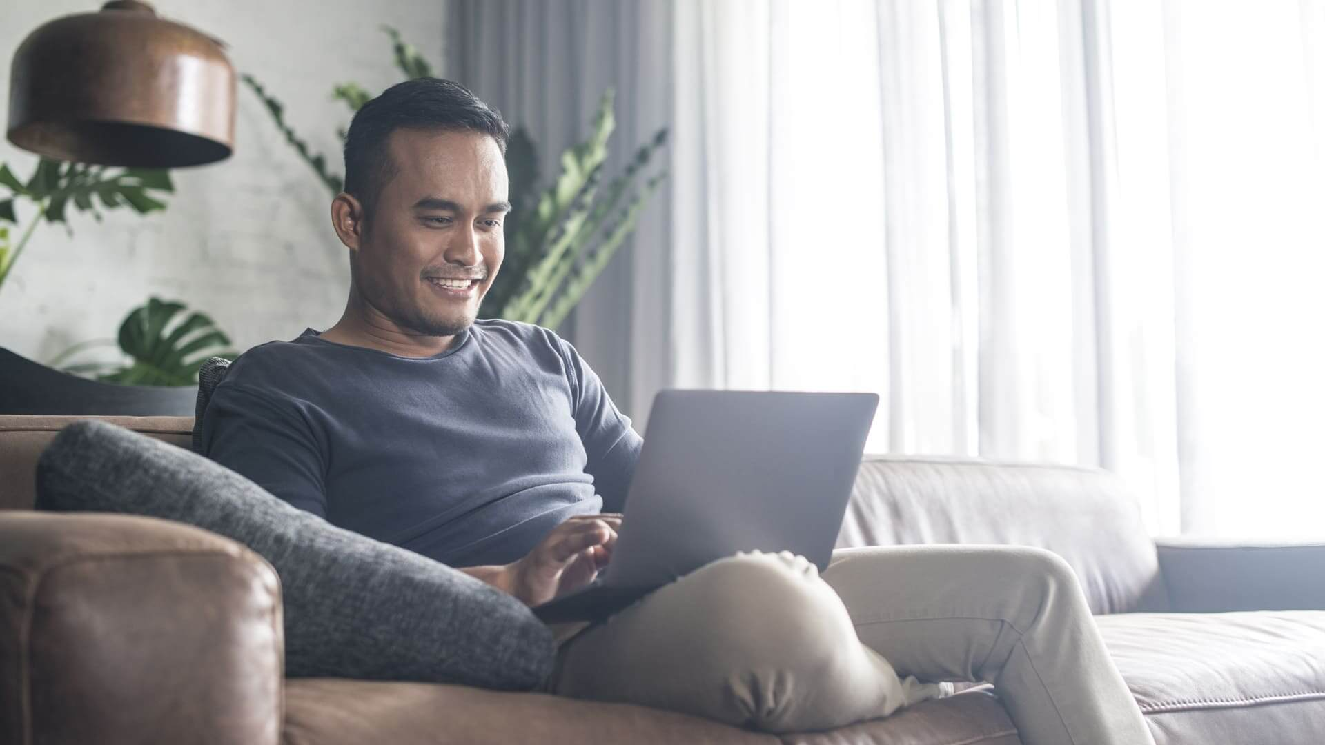 man in home on laptop