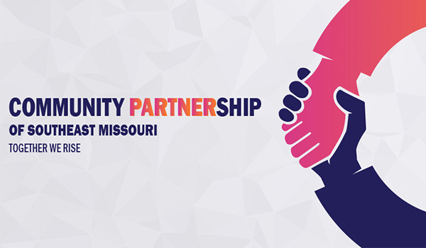 community Partnership banner with logo