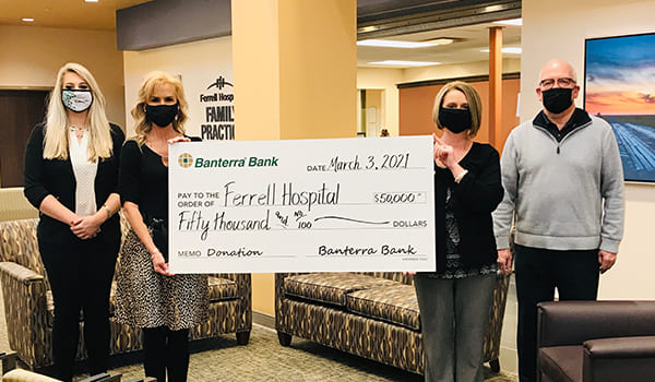 Ferrell staff posing with big check