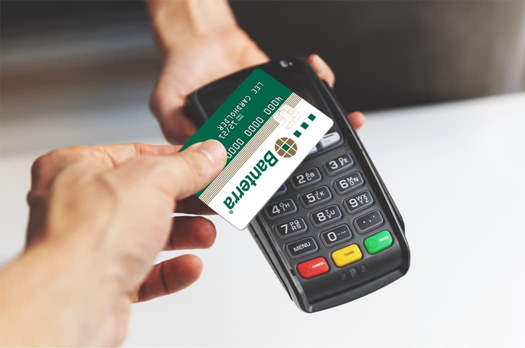 person making contactless payment with Banterra debit card